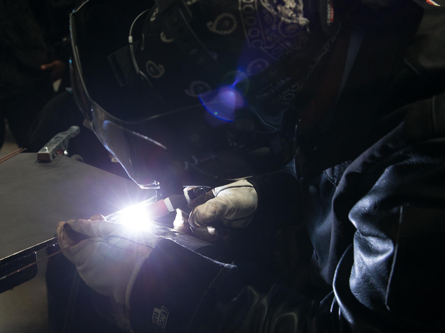 Welding student welding creating a bright light